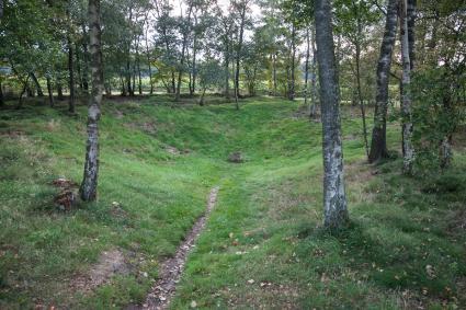 De 'Germaanse Put' bij Lunteren. Prehistorische waterput met een reconstructie van de originele uit © Bert van As
